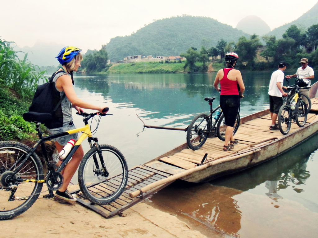 Cycling tour team cross the river